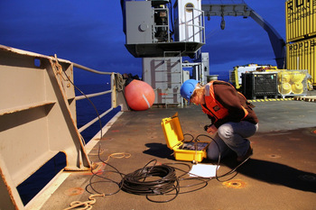 Dana interrogates the seismometer from deck